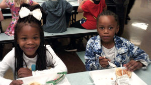 Two Jefferson students pose for a picture while enjoying their pancake breakfast.