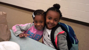 Two Jefferson students pose for the camera as they wait for their pancakes.