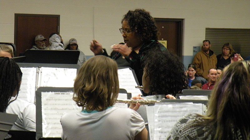 Ms. Turner conducts the band,