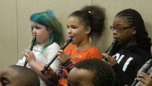 Students performing a piece on their recorders.