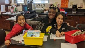 An Eighth grader spends time with two of our Second graders.