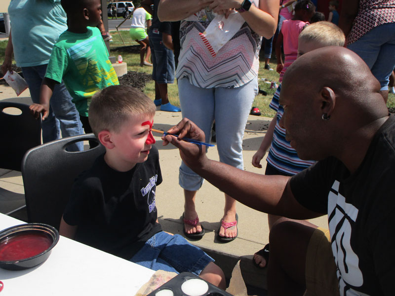 Mr. Byrd painting Chase Roberts face.
